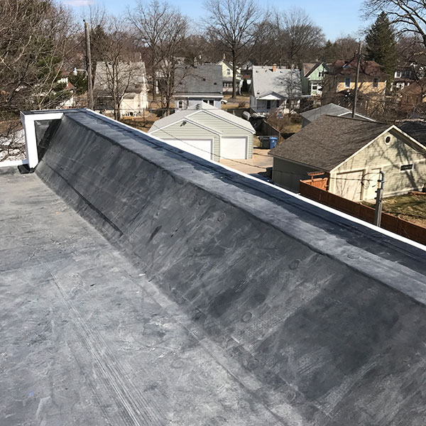 Wind Damage Flat Roof Replacement Minneapolis Iron